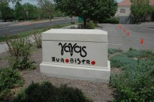 Daytime View of Ya Yas Euro Bistro Restaurant Sign